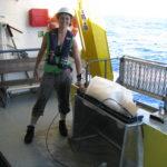 Julia Reisser stands next to the manta net onboard RV Southern Surveyor.