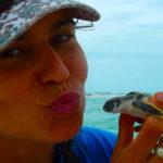 UWA PhD student Julia Reisser, with a flatback turtle hatchling