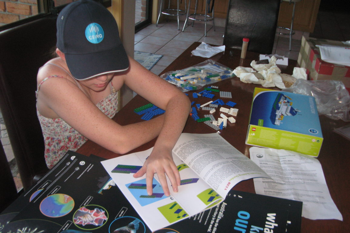 Clare Cameron at home with her LEGO® Investigator (image Catherine Cameron).