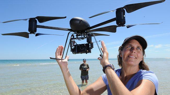 Denise Hardesty with helicopter