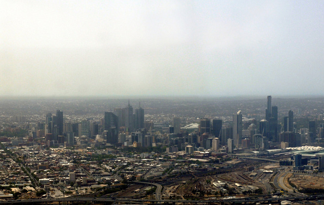 A blanket of smoke due to bushfires approaches Melbourne, Friday, Dec. 8, 2006. Eighteen fires are currently burning across state forests and the Alpine National Park in the north east and Gippsland region, blackening about 150,000 hectares. (AAP Image/Julian Smith)