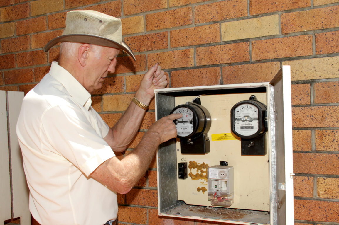 Man checking the electricity meter