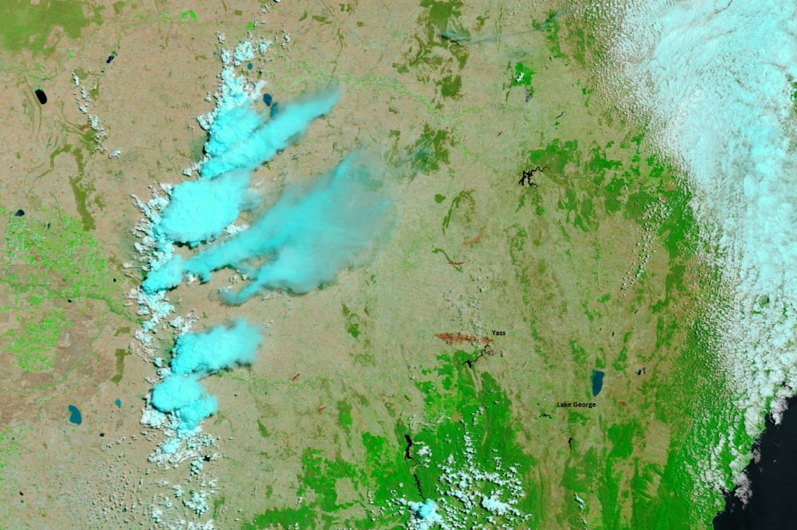 Satellite image looking down over parts of NSW and Victoria showing smoke plumes