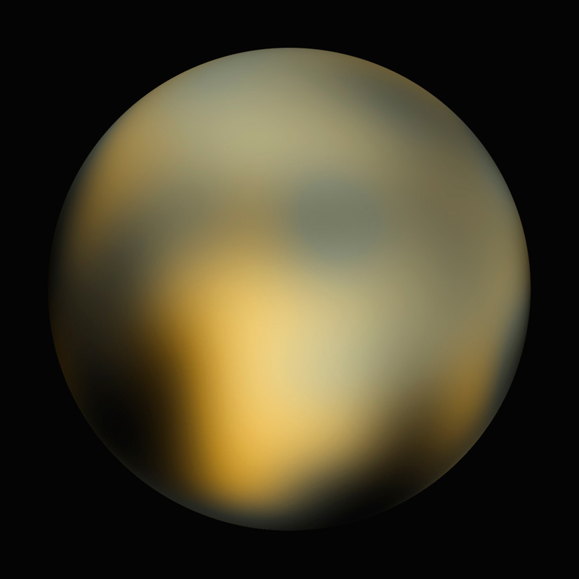 Pluto as seen by the Hubble Space Telescope. Image Credit NASA, ESA and M.Buie (Southwest Research Institute)
