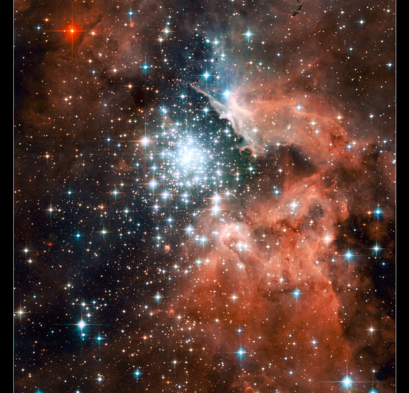 A cluster of bright stars surrounded by pink clouds of gas.
