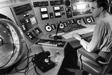 Astronomer Frank Kerr at the control desk of the Parkes radio telescope in 1962.