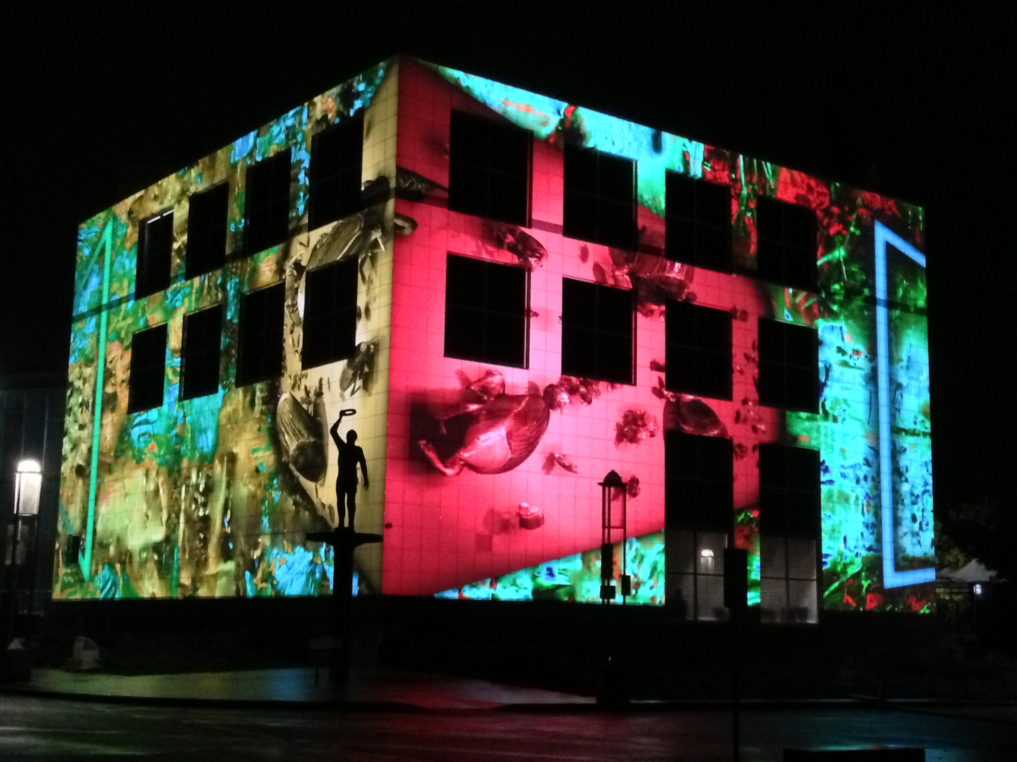 Building with coloured lights projected onto it