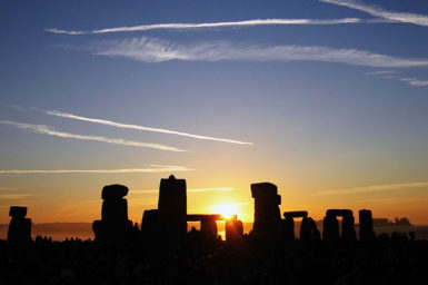 The sun rising over Stonehenge in Britain.
