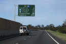 road sign showing distance to Canberra
