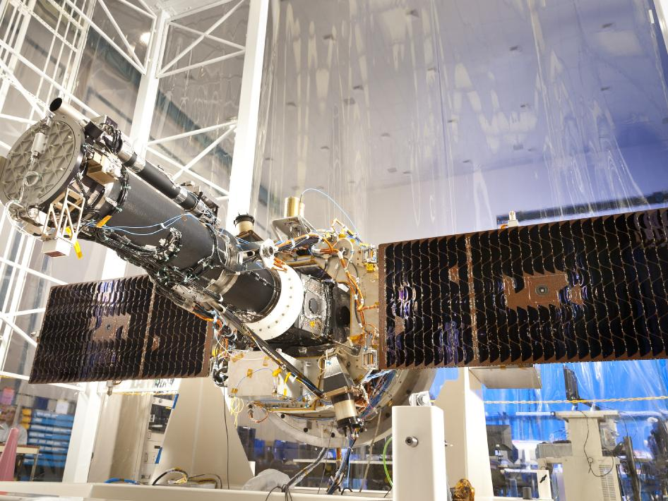 The fully integrated spacecraft and science instrument for NASA's Interface Region Imaging Spectrograph (IRIS) mission is seen in a clean room at the Lockheed Martin Space Systems Sunnyvale, Calif. facility. The solar arrays are deployed in the configuration they will assume when in orbit. Credit: Lockheed Martin.