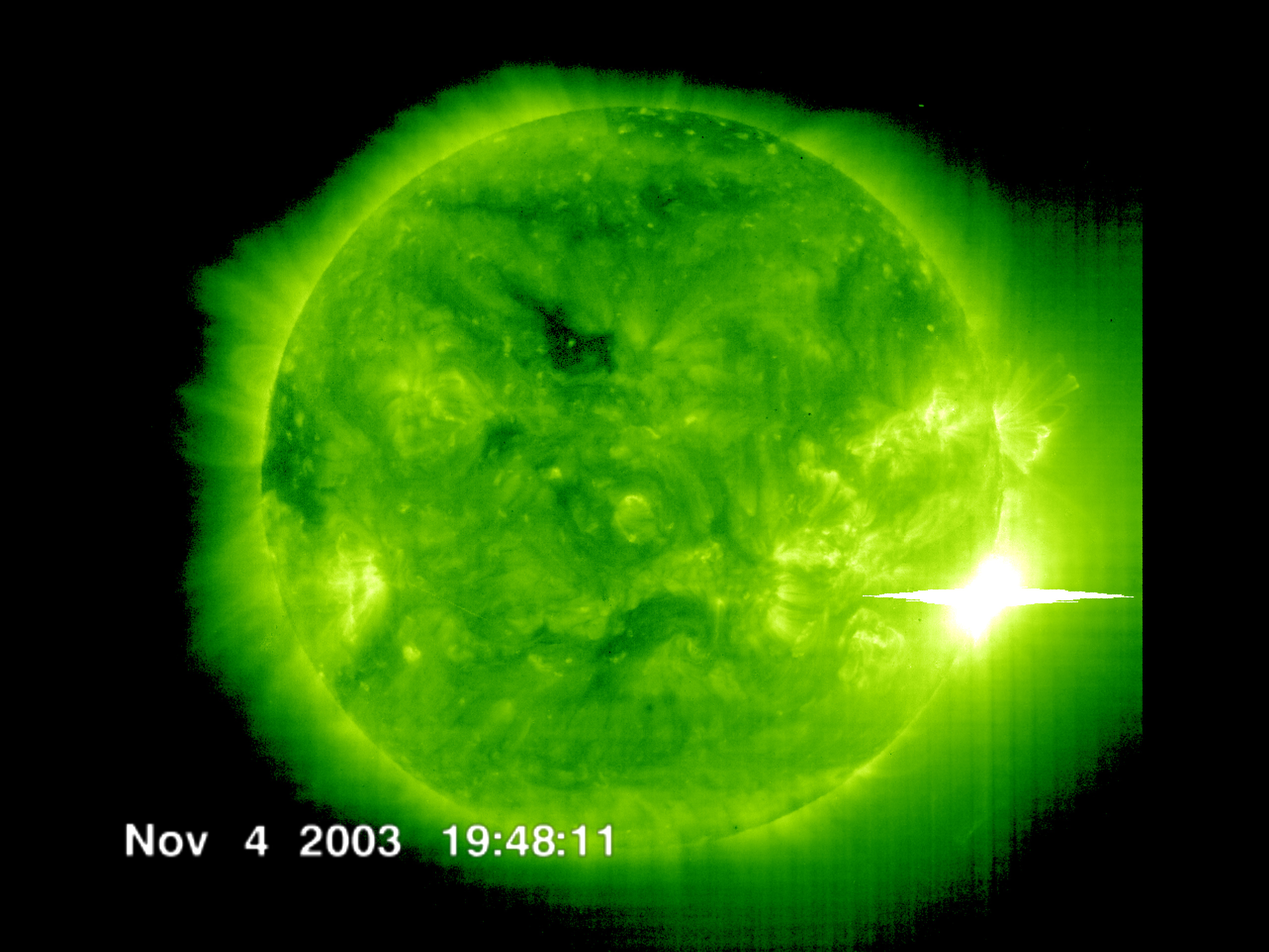 The Solar and Heliospheric Observatory spacecraft captured this image of a solar flare as it erupted from the sun early on Nov 4, 2003. This was the most powerful flare measured with modern methods. Credit: ESA and NASA/SOHO