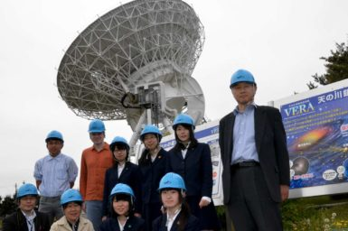 Students in front of the VERA radio telescope.