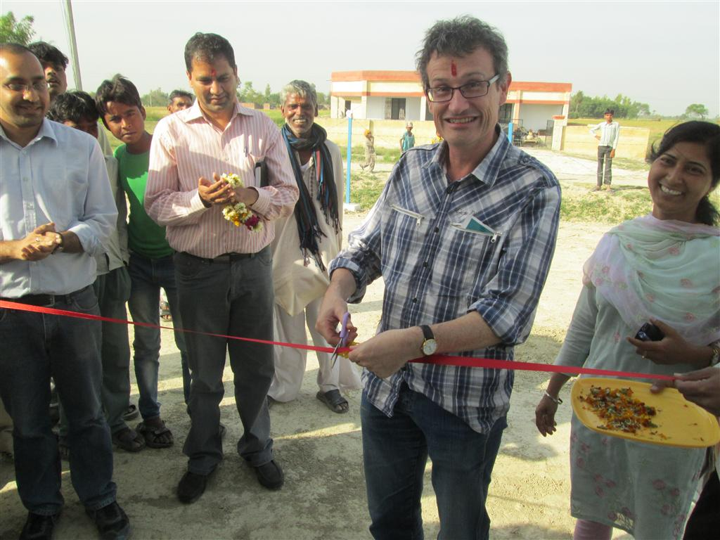 Dr Stephen White receiving a traditional Indian garland from a local village resident to celebrate the opening of the biomass power station.