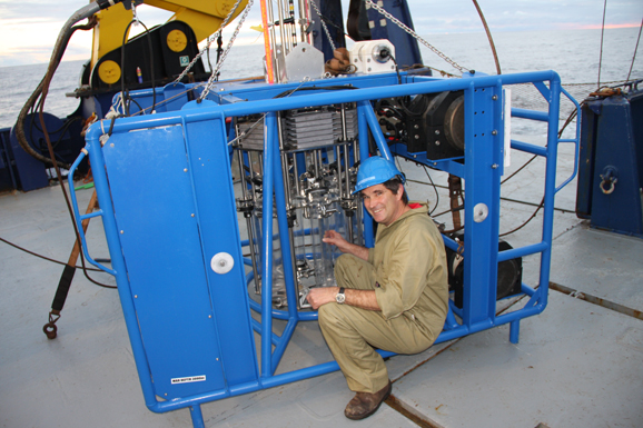 Matt Sherlock with the Integrated Coring Platform (ICP). This instrument is lowered to the seafloor, where it collects a set of six sediment cores, along with a water sample. On the way down, and the way back up, it also collects information on the presence of hydrocarbons, and sends out an acoustic signal (much like that of a depth sounder on a boat) to measure fish and plankton presence.