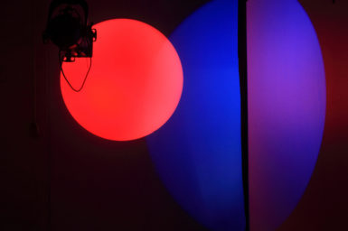Two large spots of light, red and blue.