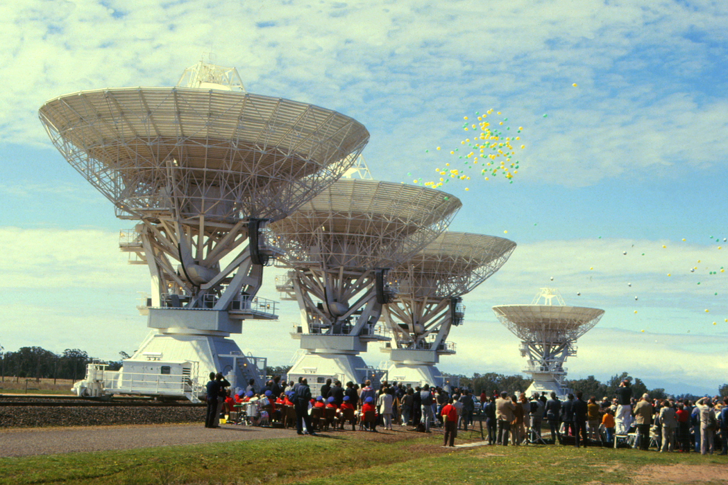The telescope was declared open for business, then three antennas slowly tipped, spilling out streams of green and gold balloons that whirled away into the sky. (Credit: CSIRO archive)