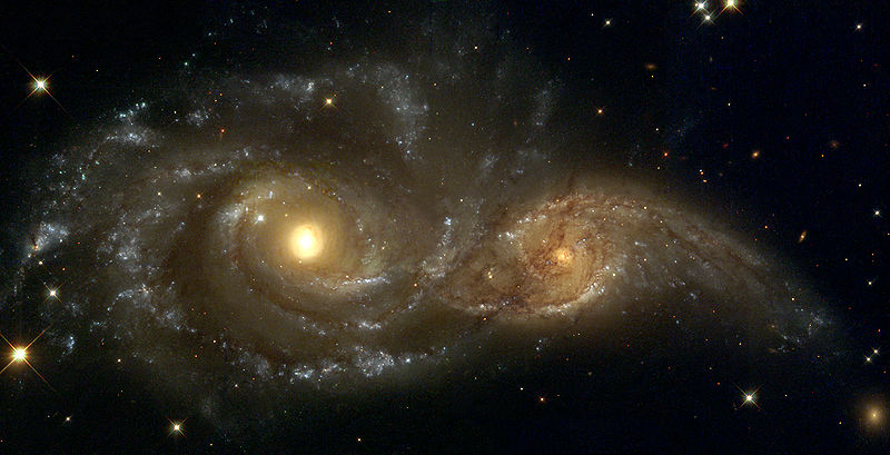 Two spiral galaxies close together.