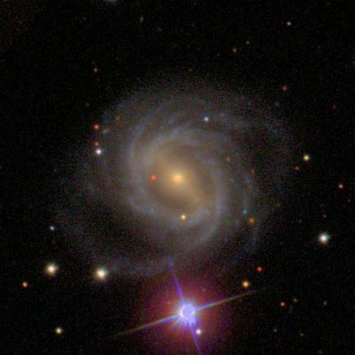 A spiral galaxy and a star