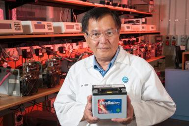 Dr Lan Lam holding the UltraBattery.