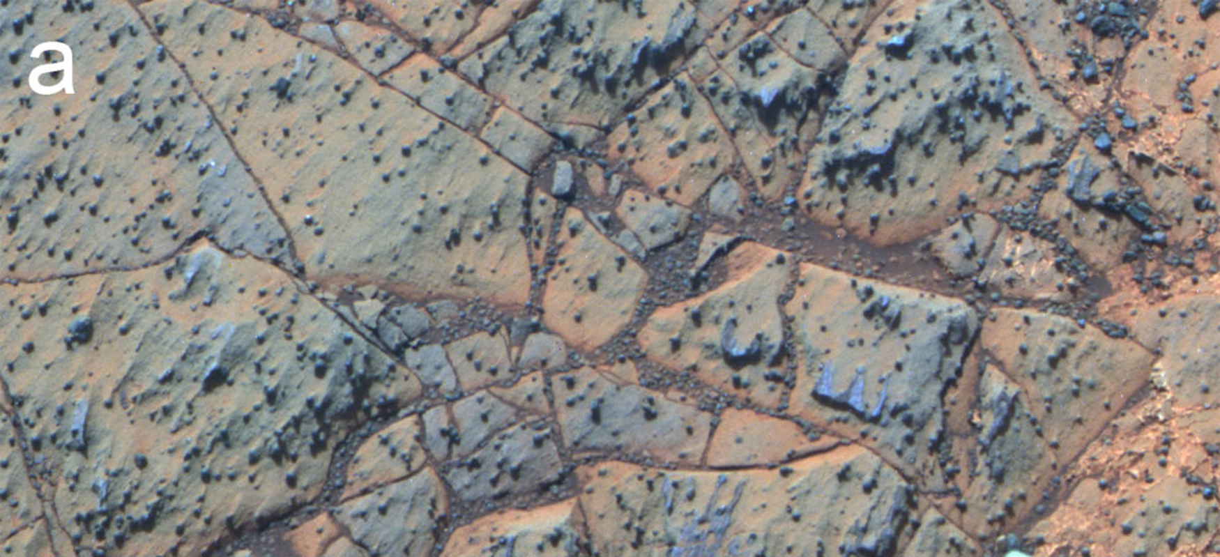 False-colour image of Matijevic formation rocks. They are 3.7 billion years old and contain evidence that fresh water once flowed over them. Image: Science/AAAS.