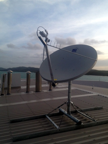 A satellite broadband dish on a roof