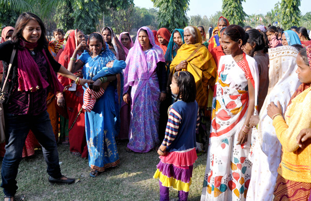 One of our researchers, Dr Anu Kumar (left), discussing safe water with village women.