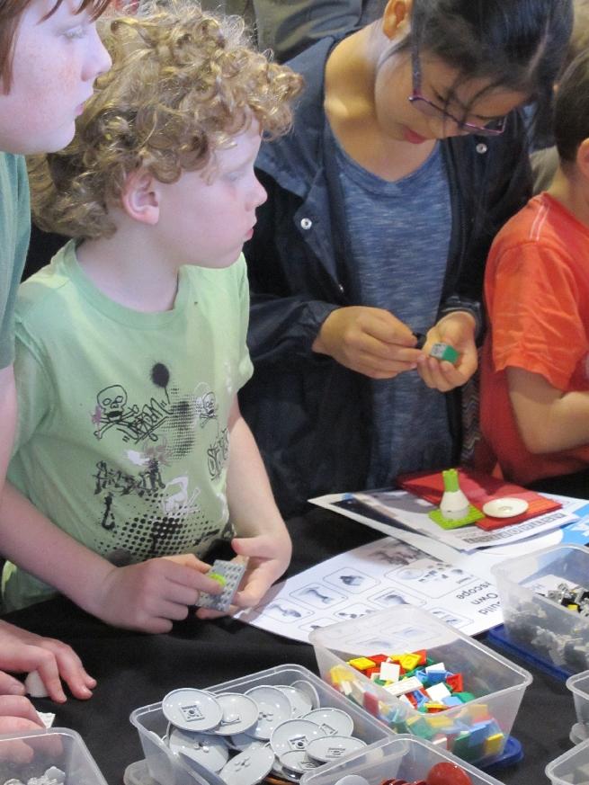 Children building SKA antennas in Lego at the SKA stand.