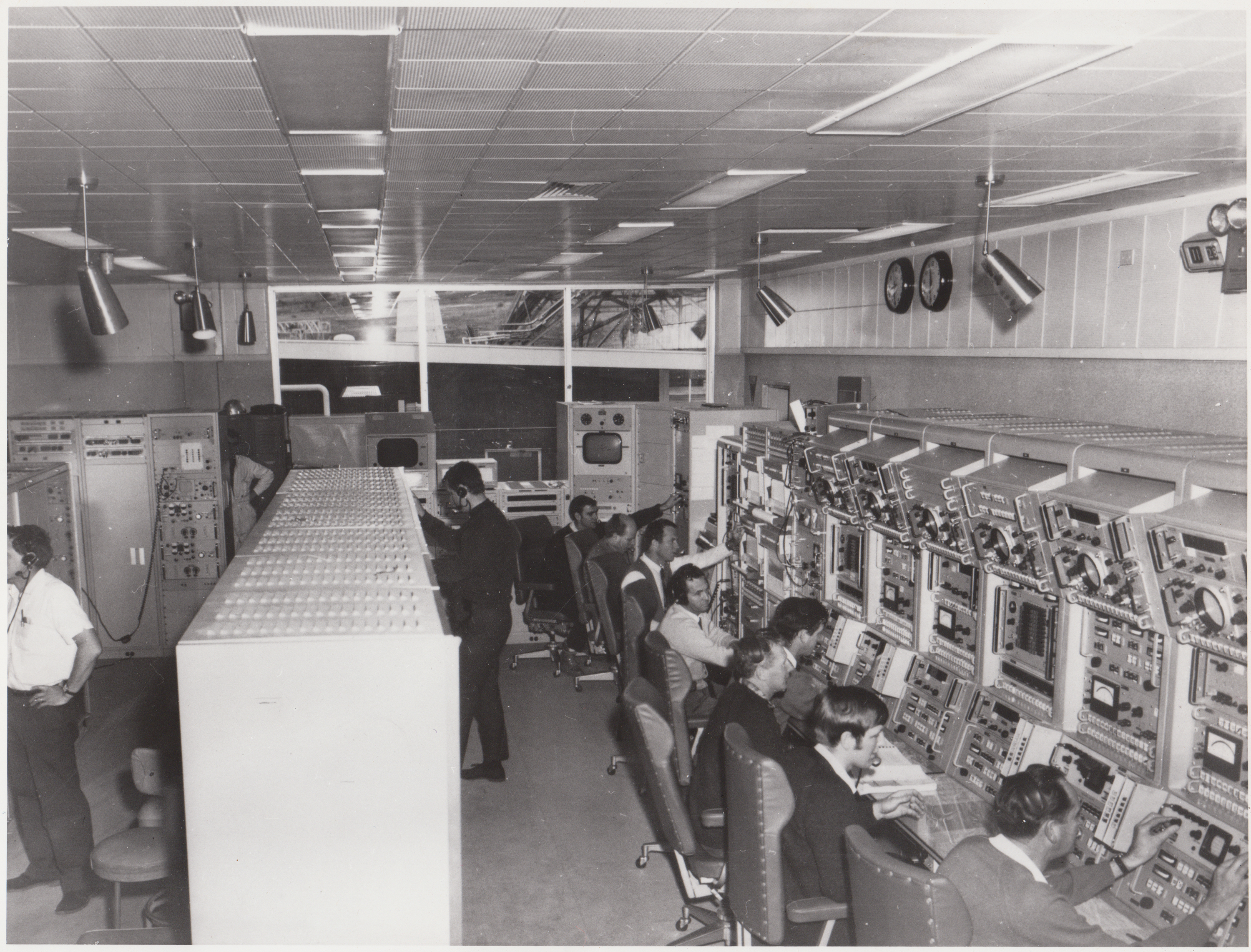 The control room for DSS42, the station's original antenna which started life as a 26-m dish antenna, and expanded to 34-m for later missions. Dozens of operators were on duty at any one time monitoring individual systems. Today a centralised control room operates all the station's antennas with a team of only 5 or 6, thanks to technological progress.