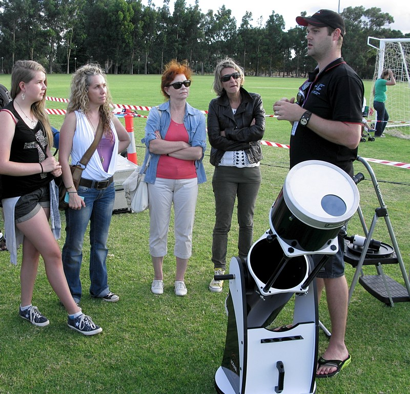 ICRAR Outreach Manager discussing solar viewing with Astrofest visitors.