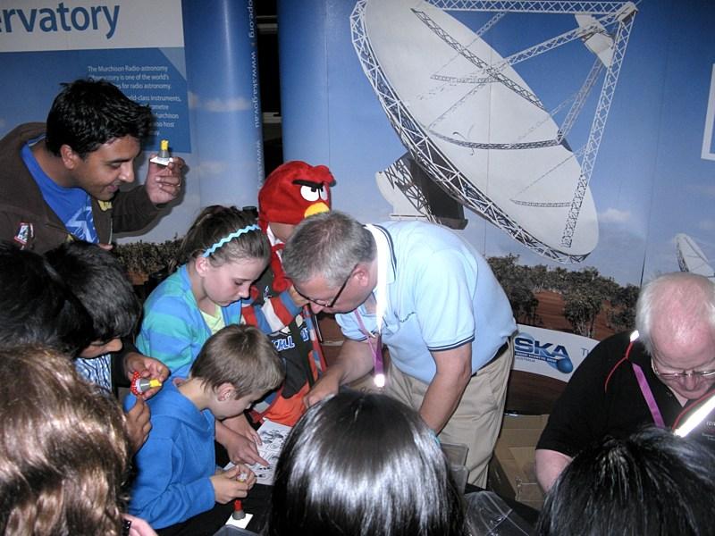 CSIRO's Dr Phil Crosby helping some children construct their own Lego SKA antennas.