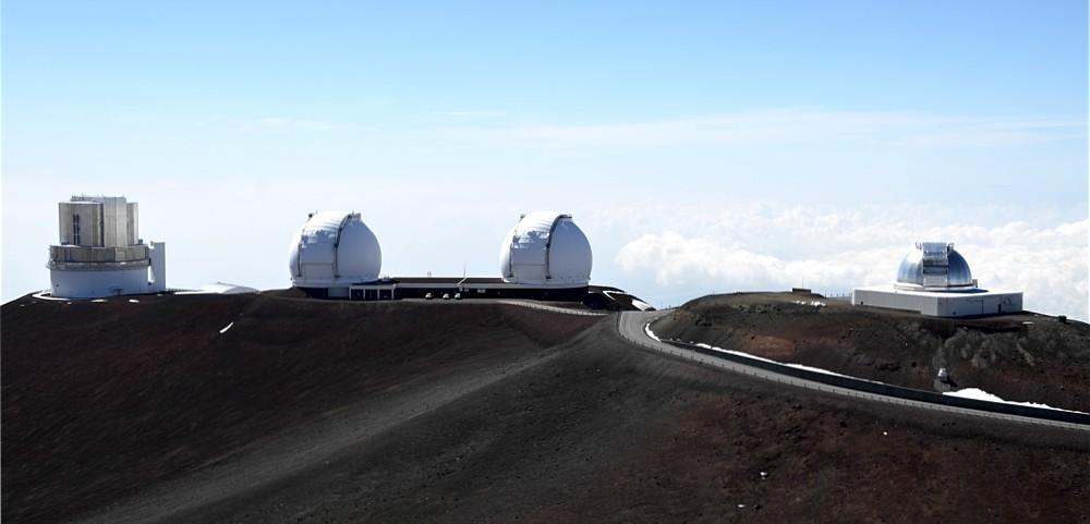The Subaru telescope (L), the twin Keck telescopes (C)) and the NASA Infrared Telescope Facility (R) on Mauna Kea.