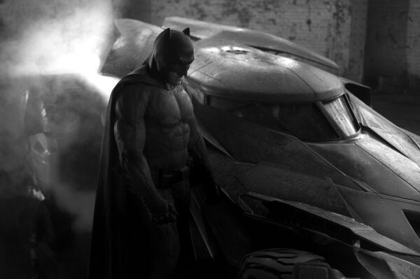 A black and white photo of the new Batman and Batmobile.