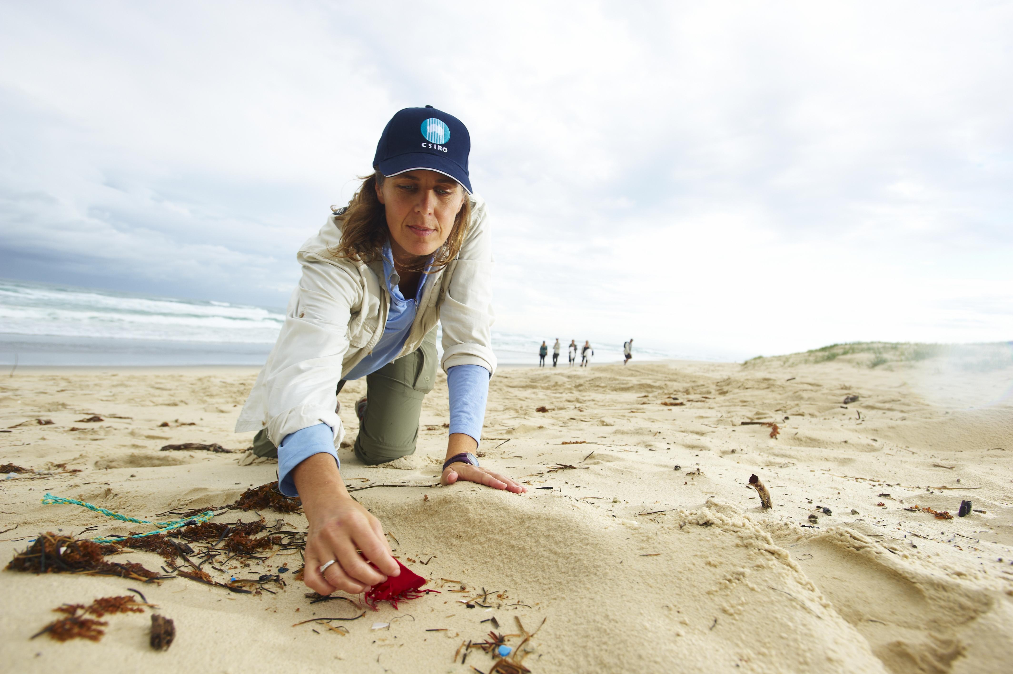 Denise Hardesty inspects debris