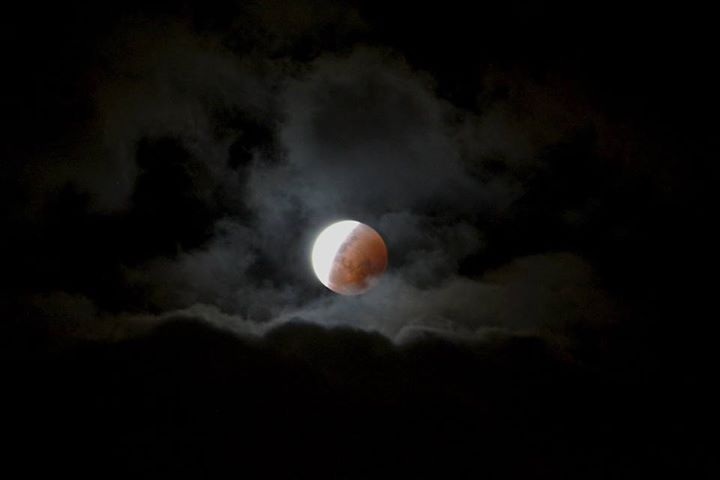 Eclipse through clouds