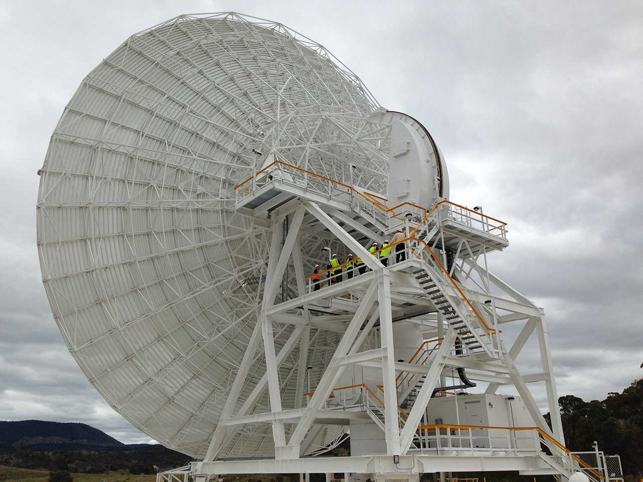 GIANT: People are turned into small toys against the enormous size of Deep Space Station 35's 34-metre dish.