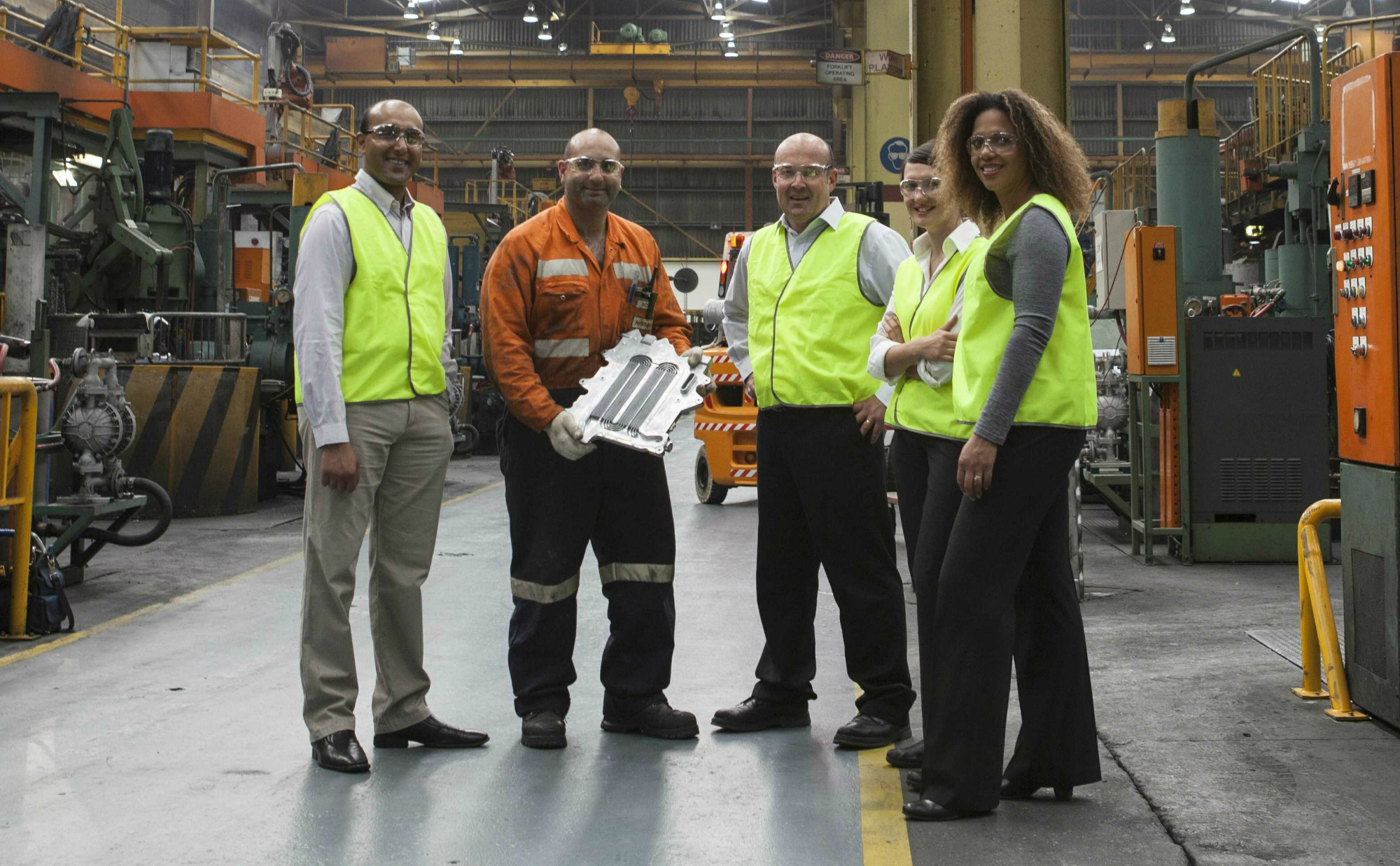 Smiles all around. The Victorian facility in South Dandenong will continue making parts to export around the world.