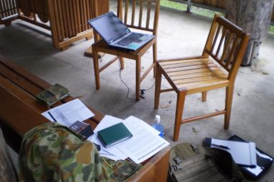 A miltary psychologist's interviewing set-up in an open-air chapel.