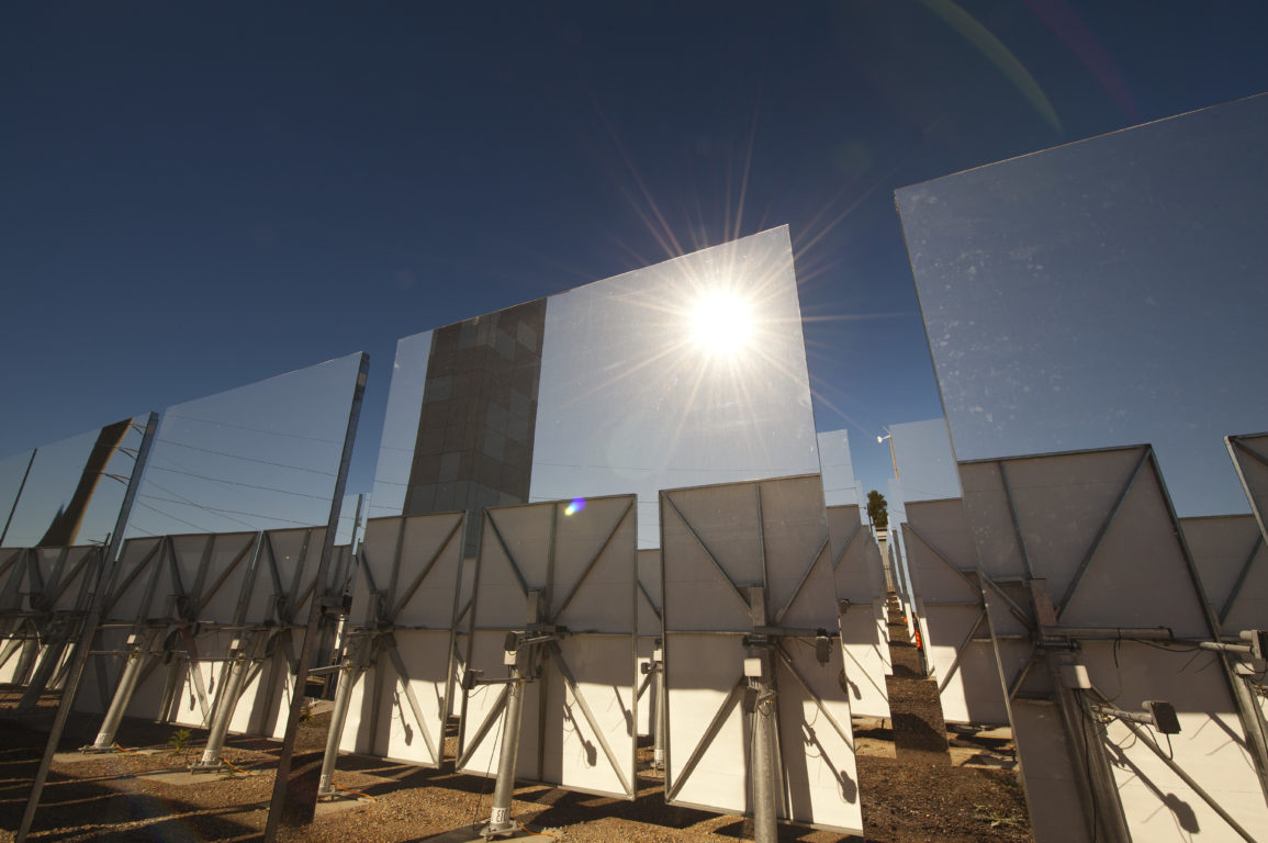 Solar field with sun reflected in mirror