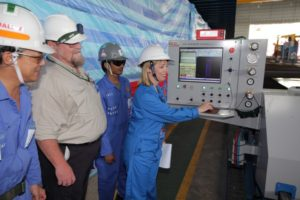 Toni Moate presses the button to commence steel cutting on RV Investigator