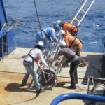 Preparing the vibro corer on the back deck of Southern Surveyor 1 (image MNF + Bruce Barker