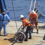 Preparing the vibro corer on the back deck of Southern Surveyor 3 (image MNF + Bruce Barker)