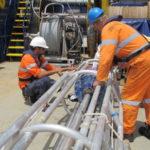 Preparing the vibro corer on the back deck of Southern Surveyor (image MNF + Bruce Barker)