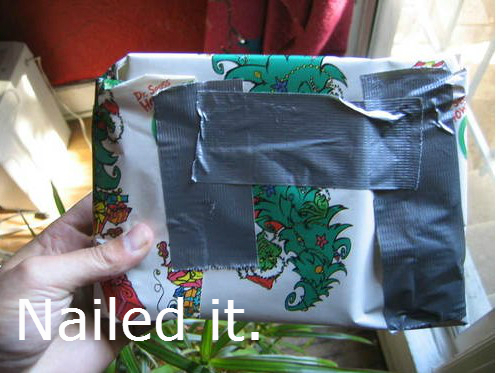 Present wrapped with duct tape with text: Nailed It.