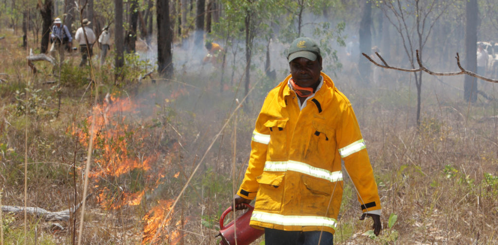 Marcus Cameron of Manwurrk Rangers laying a fire break for traditional management of country in the Djelk and Warddeken Indigenous Protected Areas.
