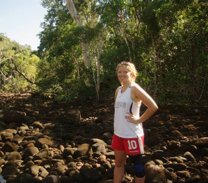 Alyssa Bowden standing on drive river bed in bush.