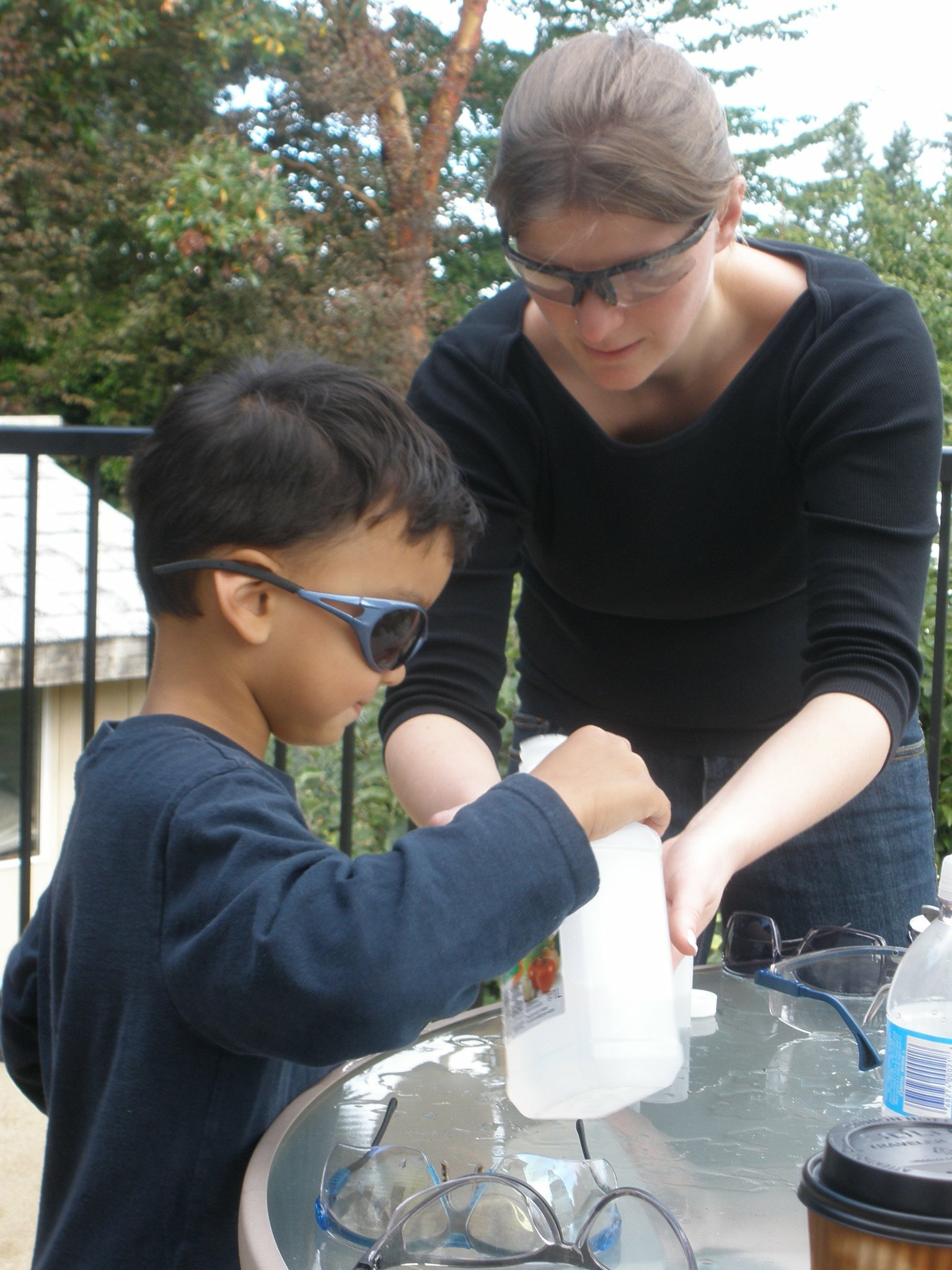 Cath Shepherd helping young boy with science project.