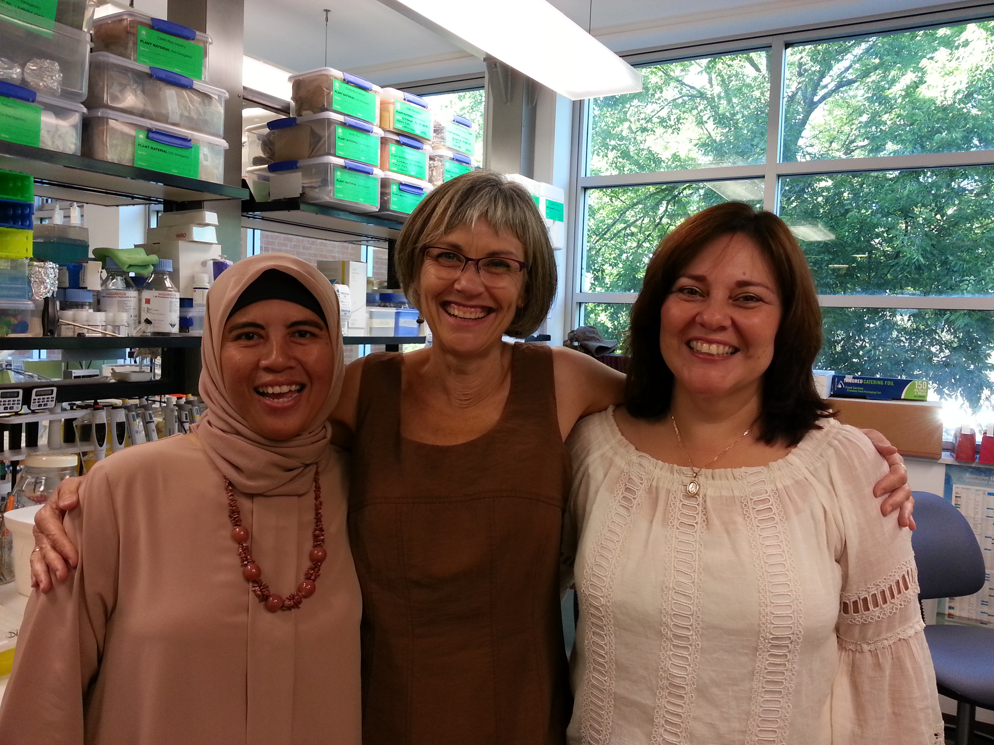 A smiling team of Dina, Judith and Lissette at their lab in Canberra