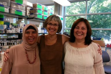 Dina, Judith and Lissette standing together in research facility