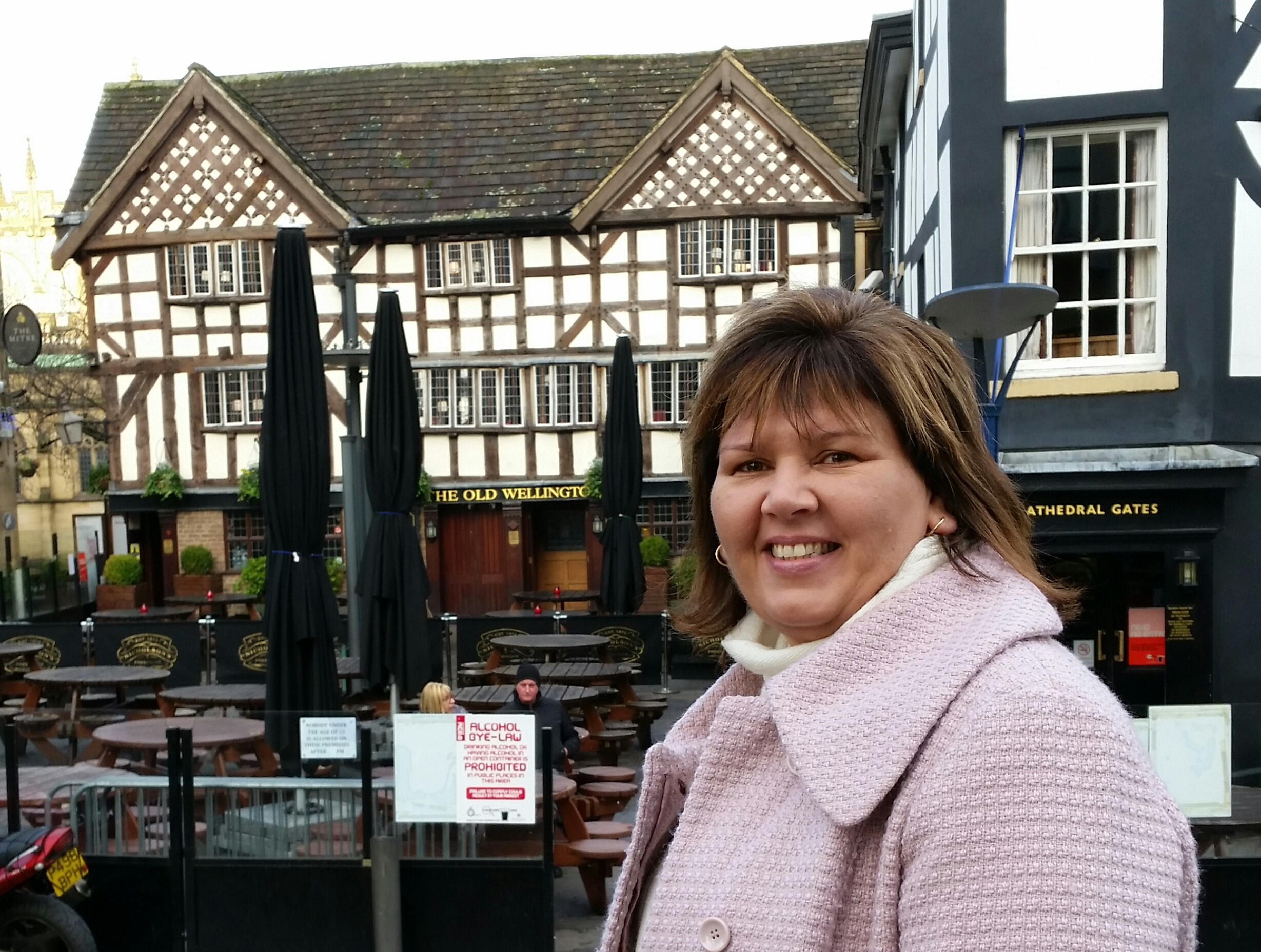 Donna Smith in front of old English pub