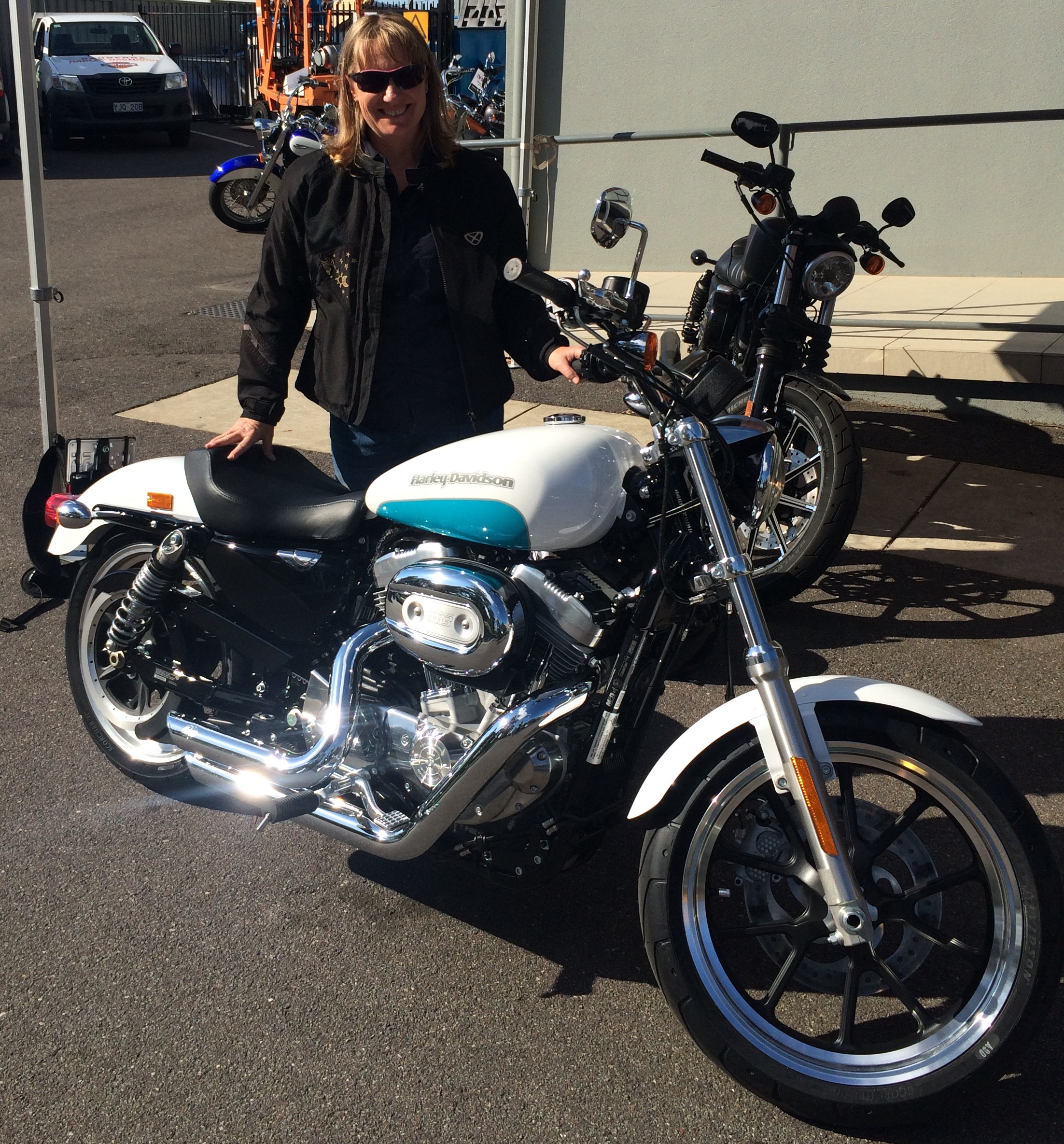 Heather Blair with a Harley Davidson motorbike